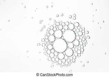 Oil drops in water on a white background