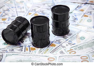 Oil drums on US dollars background