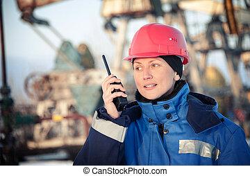 Oil engineer. Toned. - Female worker in the oil field...
