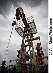 Oil exploration closeup low angle view - Oil rig pump...