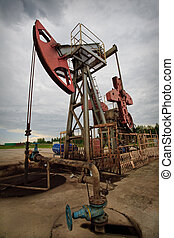 Oil rig pump closeup low angle view