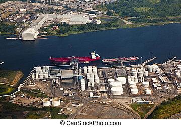 Oil farm with river