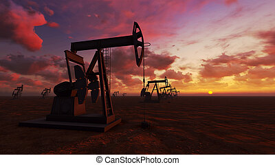 Oil field at sunset - Oil field pump jacks at sunset