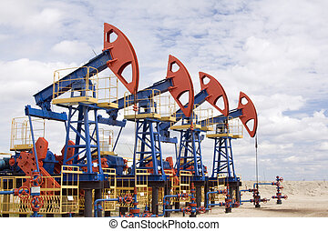 Oil field - Oil and gas industry. Work of oil pump jack on a...