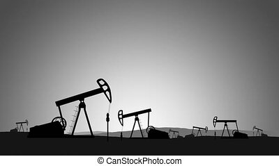 Silhouettes of oil rigs on the horizon