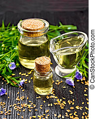 Oil flaxseed on dark wooden board
