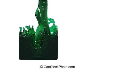 oil. green liquid fills up a rectangular container