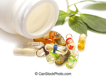 oil herbs capsul on isolate. Alternative medicine concept