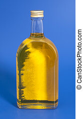Oil In Glass Bottle On A Blue Background