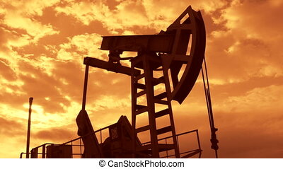 Oil industry equipment pump jack in motion at sunset