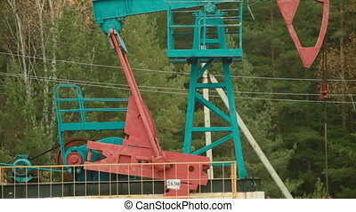 Oil Industry Pump jack in forest - Oil Industry Pump jacks...