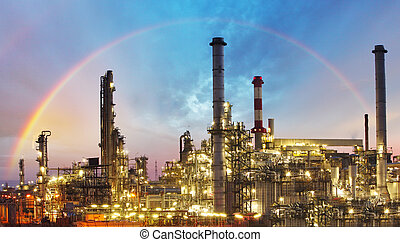 Oil indutry refinery - factory with dramatic sunset