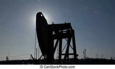 Oil jack sillouhette - This is a lone oil jack working at...