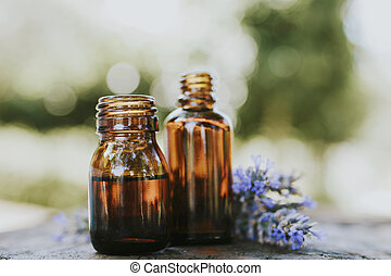 oil jars or lavender essence with a bouquet of natural lavender flowers