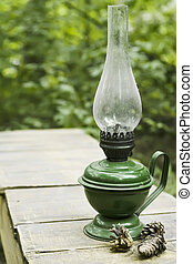 Country life item-ancient oil lamp under layer of dust