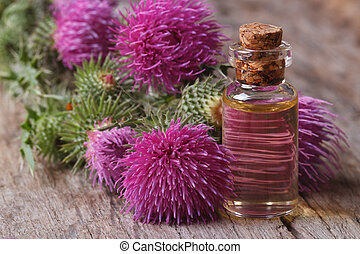 Oil of burdock close-up on a table in a glass bottle...