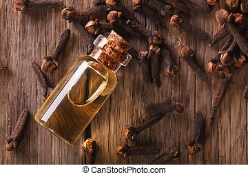 Oil of cloves close-up on the table. horizontal top view - ...
