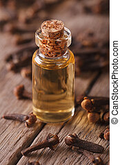 Oil of cloves in a glass bottle on a table macro