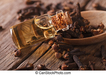 Oil of cloves in the bottle close-up horizontal - Oil of...