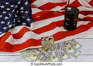 Oil of the black barrel of oil of one hundred US dollar bills on a flag of the USA