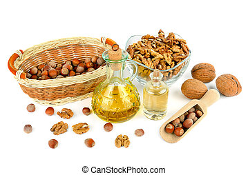 Oil of walnut and hazelnut, nut fruit isolated on white .