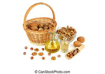 Oil of walnut and hazelnut, nuts fruit isolated on white background.