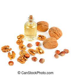 Oil of walnut and hazelnut, nuts isolated on white background.
