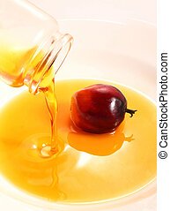Oil palm fruit and cooking oil - A bottle of palm cooking ...