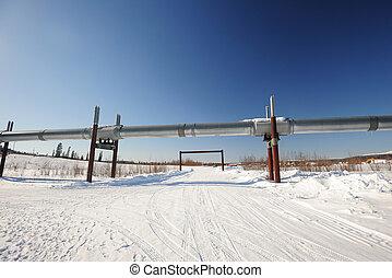 oil pipeline in alaska in winter near dalton highway