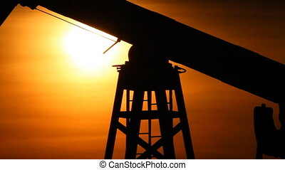 Oil production. Oil pumps at sunset