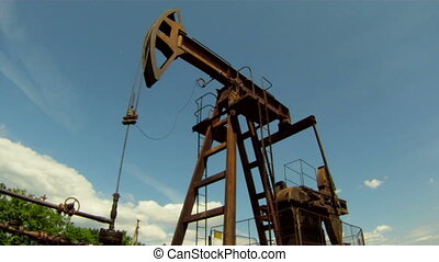 Oil Production - Oil rig extracts resources from the earth....