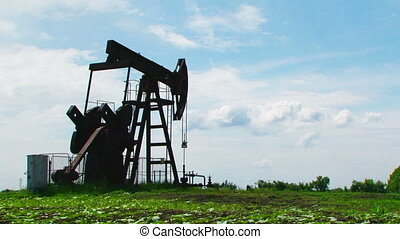 Oil Pump Digging While Producing Natural Gas - Low angle...