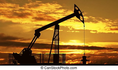 Oil pump jack against sunset - Oil pump jack silhouette...