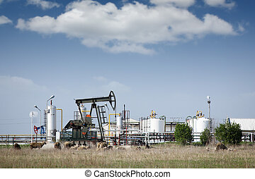 oil pump jack and refinery on field