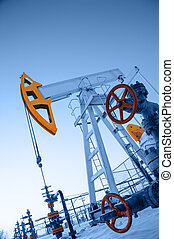 Oil pump jack and wellhead in the oilfield