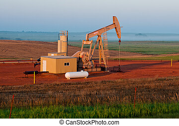 Oil Pump Jack in the Fields of ND with Fog In the background