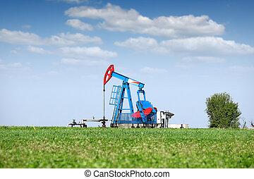 oil pump jack on field