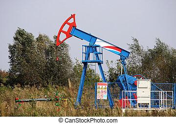 oil pump jack on windy field