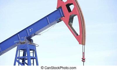Oil Pump jack over a blue sky - Industrial oil pump jacks...