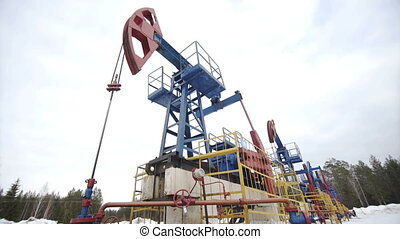 Oil Pump jack over winter sky - Industrial oil pump jacks...
