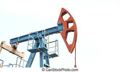 Oil pump jack rocking with pipeline. Extraction of oil, ...