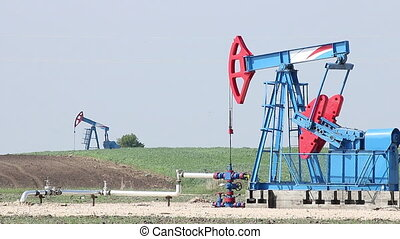 oil pump jacks on field