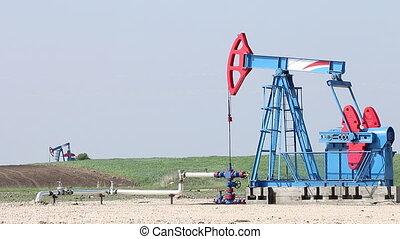 oil pump jacks work on field