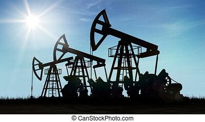 Oil Pump Jacks Working at the Sun