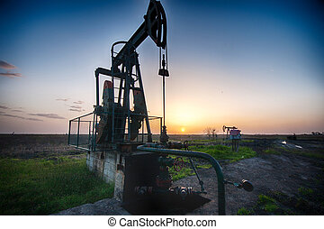 oil pump - Large pump jack pumping crude oil up to the...