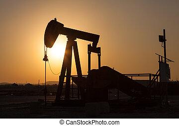 Oil pump. Oil industry equipment. - Oil pump in the desert...
