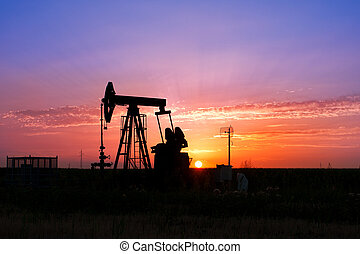 Oil Pump on orange sunset