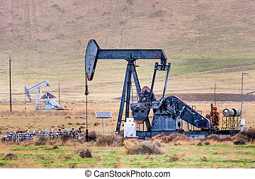 Oil pump operating on the Kern County petroleum field, Bakersfield, California