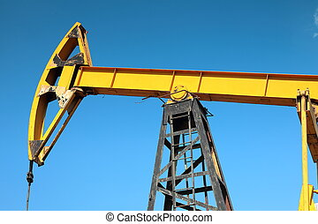 Oil pump on the blue sky background