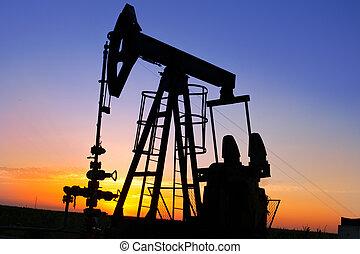 Oil Pump on orange sunset